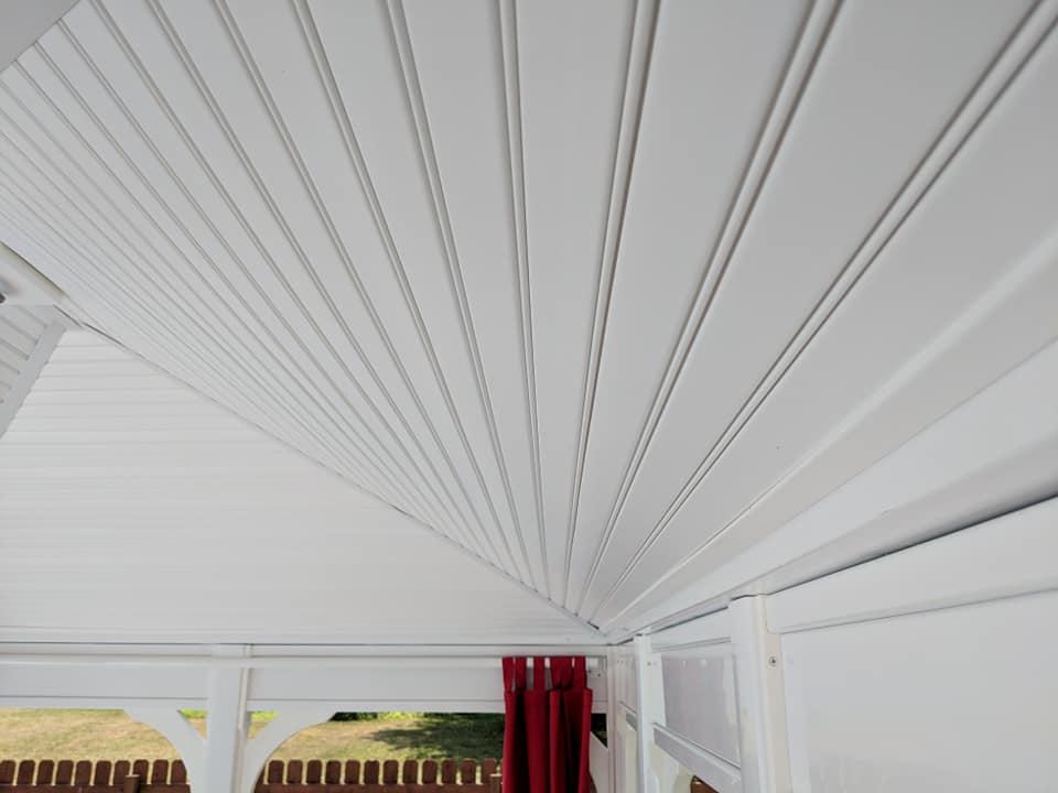 Roof on the inside of a white vinyl gazebo.