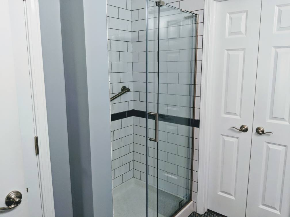 Shower remodel with subway tiles.
