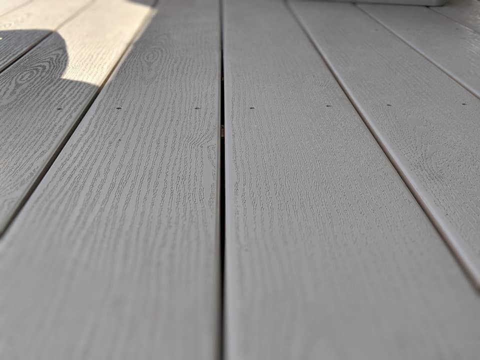 Flooring on a white, vinyl gazebo.
